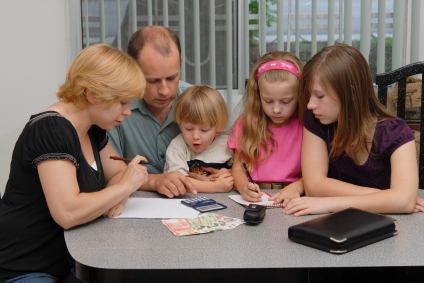Parents and children reviewing finances
